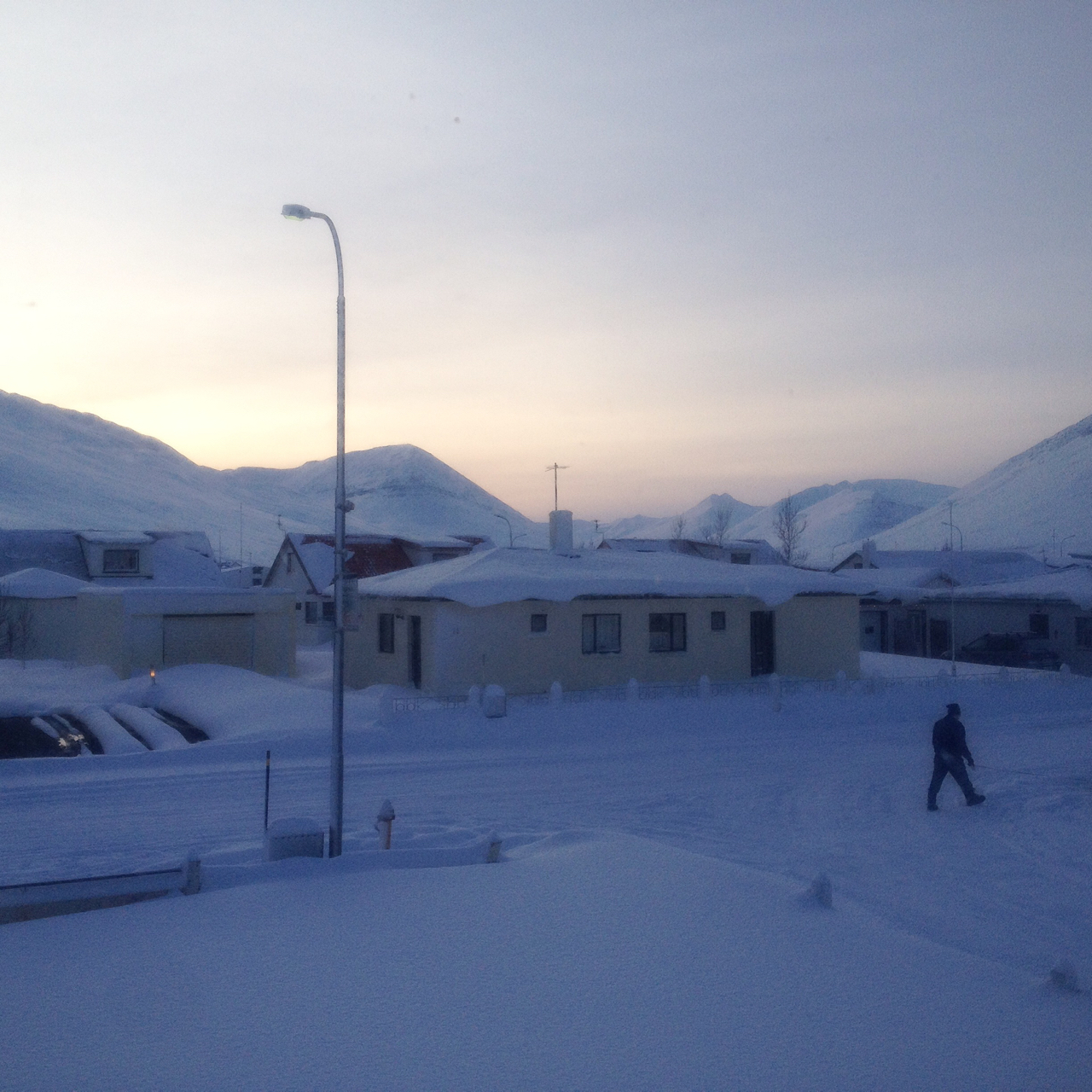 Good morning, from just below the Arctic Circle. In Iceland, it's the month of Þorri, the bleakest part of winter. It's a time for annual sacrificial feasts to the Norse thunder god Þór, for unrelenting wind, snow and sleet. In the small fishing town of Ólafsfjörður, the sun has only just returned from a 72 day hiatus behind a ring of black volcanic mountains. I'm Nastasya Tay ( @nastasyatay ), a journalist usually based in southernmost Africa, but I've been living in this town of 800 as an artist-in-residence for nearly 2 months, with photographer  @yiannishadjiaslanis , documenting how light and dark come together here - in people's lives, as well as skies - a book project that's part of our art/documentary collaboration,  @theextra.ordinary . This week, I'll be giving you a glimpse behind the double glazing, at the secret lives lived indoors, amid the shadows and the snow. But we begin by looking out, through my living room window: a late-morning sunrise last week, when gale force winds weren't rattling the windows in the morning pitch-darkness.