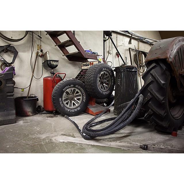 """66°09'14.1""""N 18°54'21.9""""W, 23/01/2015, 0805 Wild Country tyre, mechanic's workshop, Siglufjördur, Iceland #tyre #carparts #mechanic #wild #Iceland #winter #workshop #garage"""