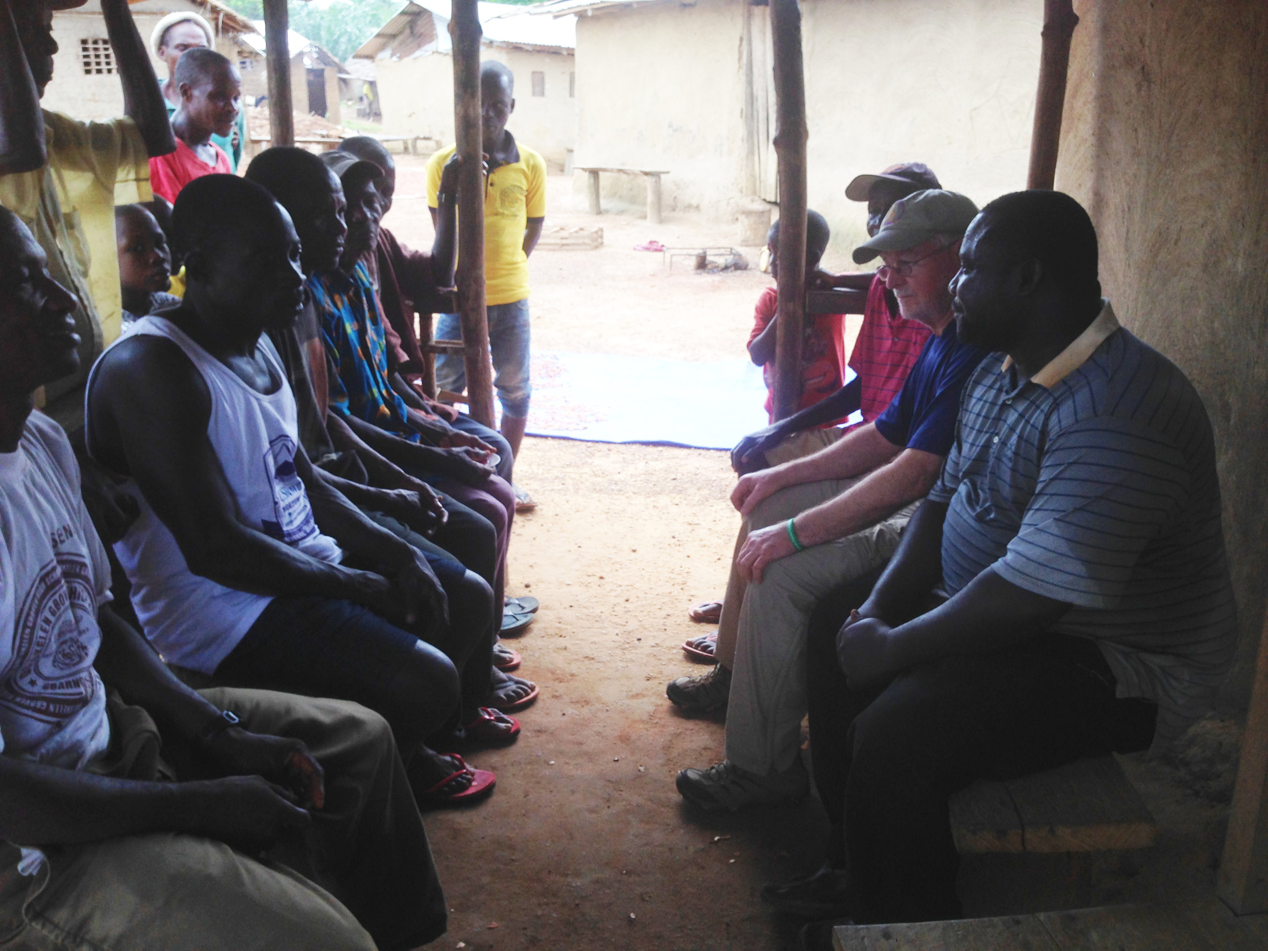 Jessy and Bill Ginn meet with village elders and cocoa farmers.