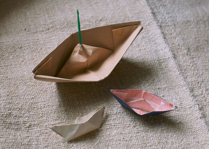Actual Papa-made paper boats. And, yes, one of them is made from a lottery ticket.