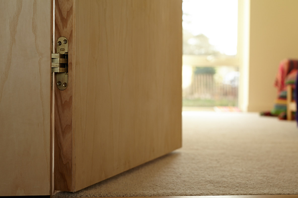 Ash Veneered secret door with concealed hinges | for further information see  Sustainable House, Norton