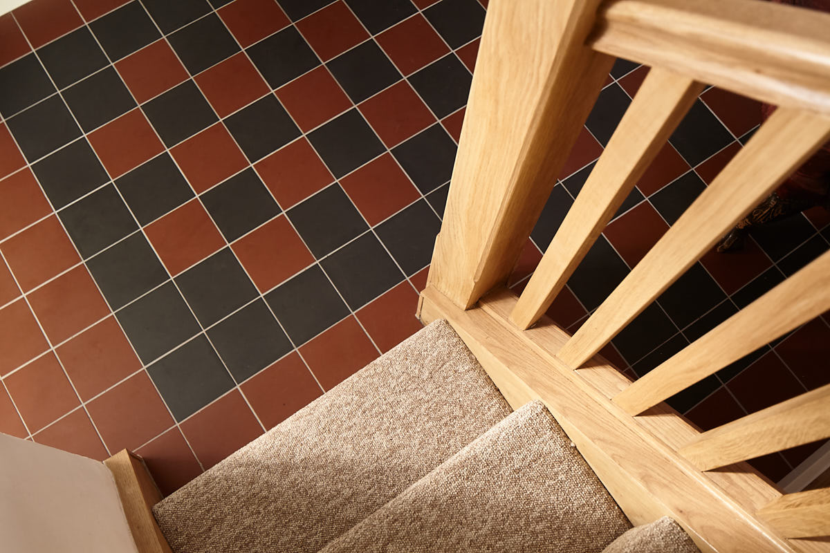 Red and Black Encaustic tiles with Oak veneered wrapping to existing staircase | for further information see  Listed Building Refurbishment, Wickham Market
