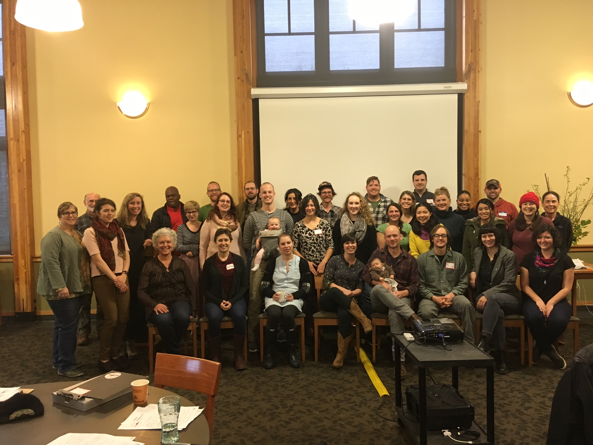 Participants from the inaugural Rethinking Rural Symposium in Fort Townsend, Washington come together for a picture. (Photo from Madeline Moore).