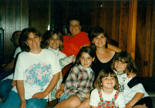 I think this photo is from 1996.  My aunt was visiting from North Carolina (she opened a B&B in Asheville, NC).  I had just finished playing soccer.  Two of my aunts, my mom, my grandmother, my cousin + my sister are also pictured.