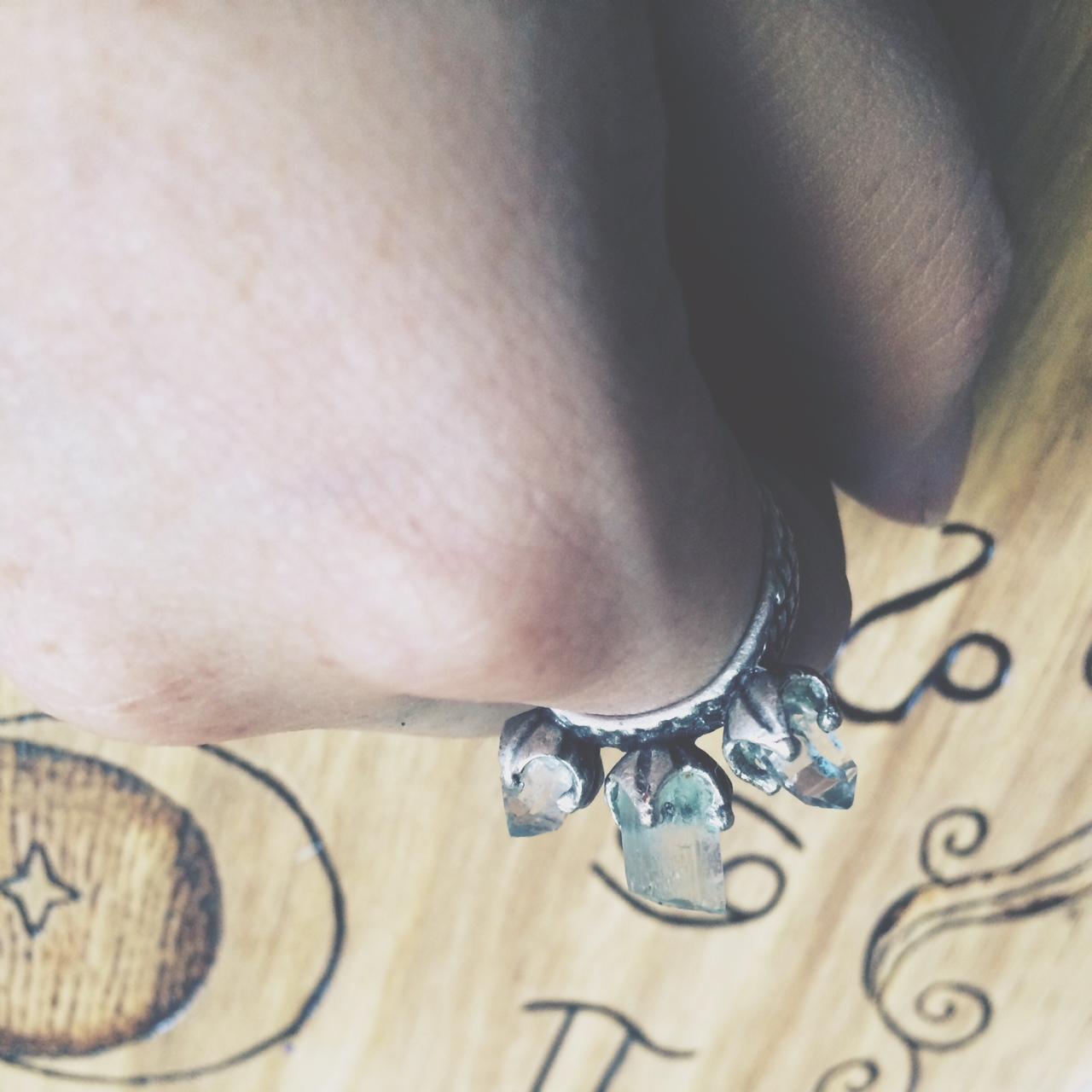 Aquamarine (center stone) and Herkimer Diamond ring from The Uncommon Wren
