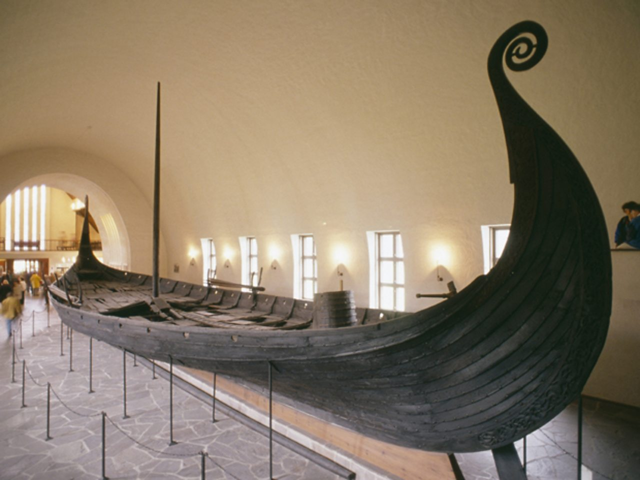 This Viking longboat, known as the Oseberg ship, was unearthed at a burial site in 1904 and is now on display at a museum in Oslo, Norway. Vikings would sail across open oceans in longboats, which were specifically designed to navigate both deep and shallow waters.