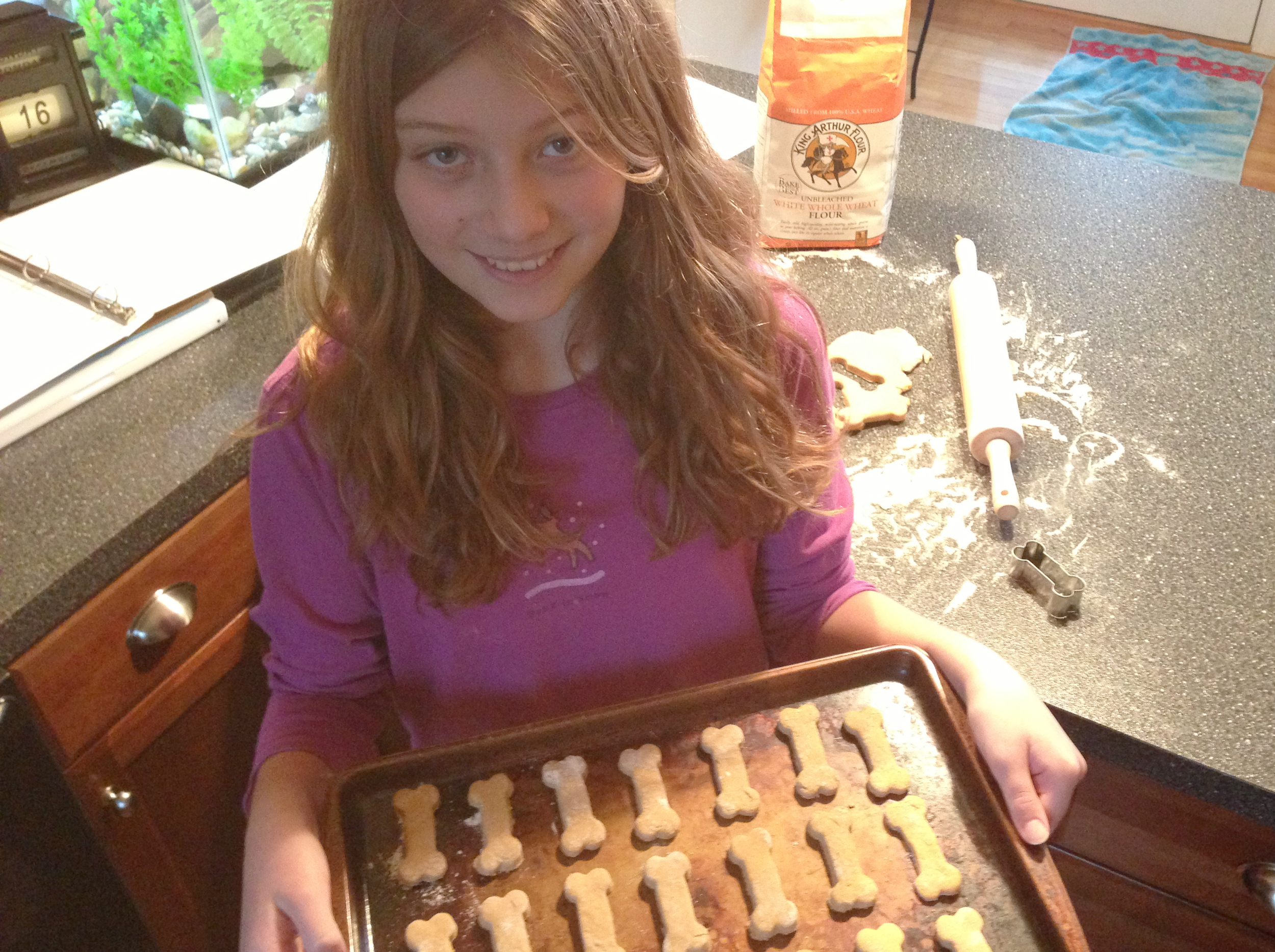 Hannah making a batch of Buster's Barkin' Good Biscuits.