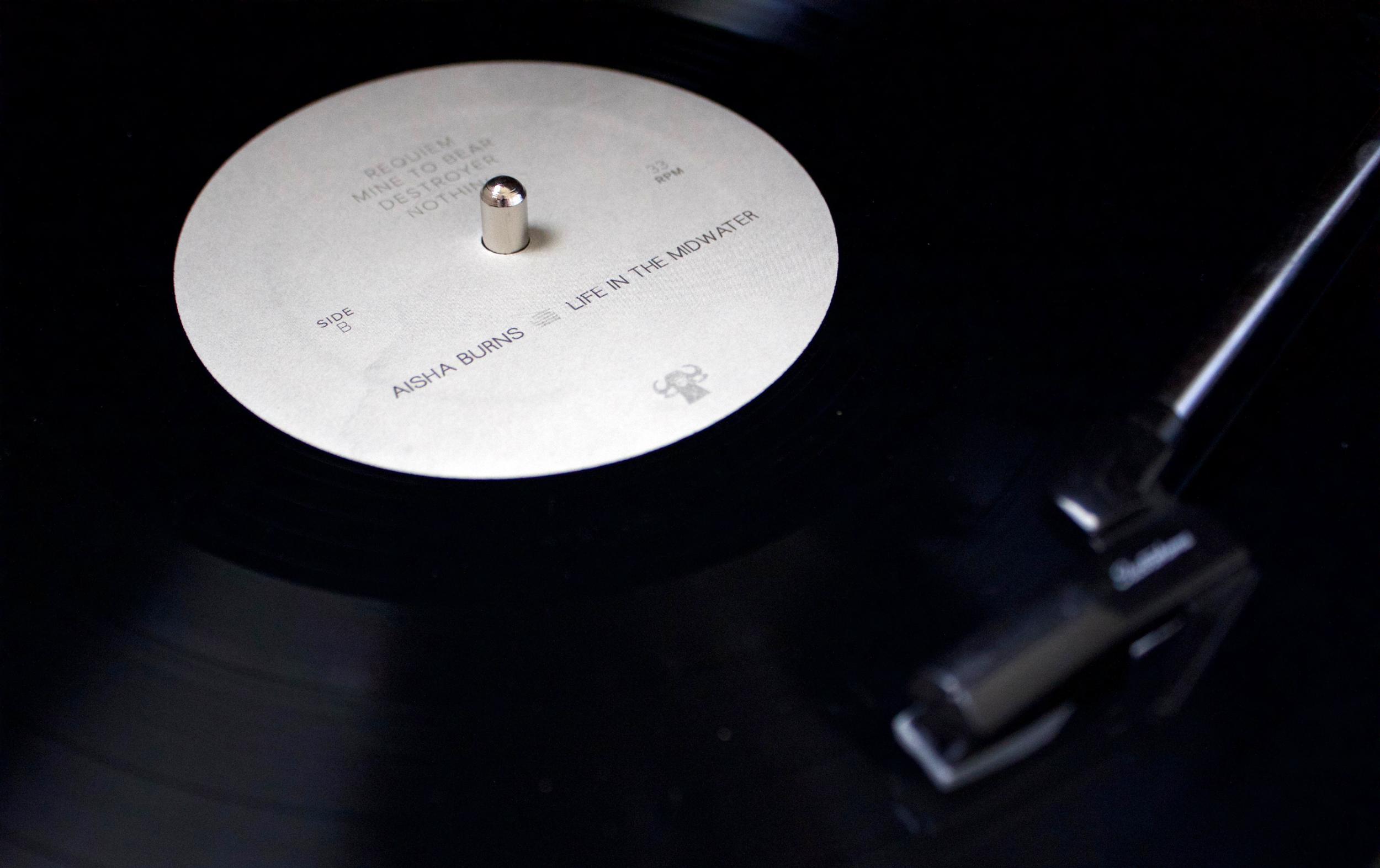 AishaBurns_record.png