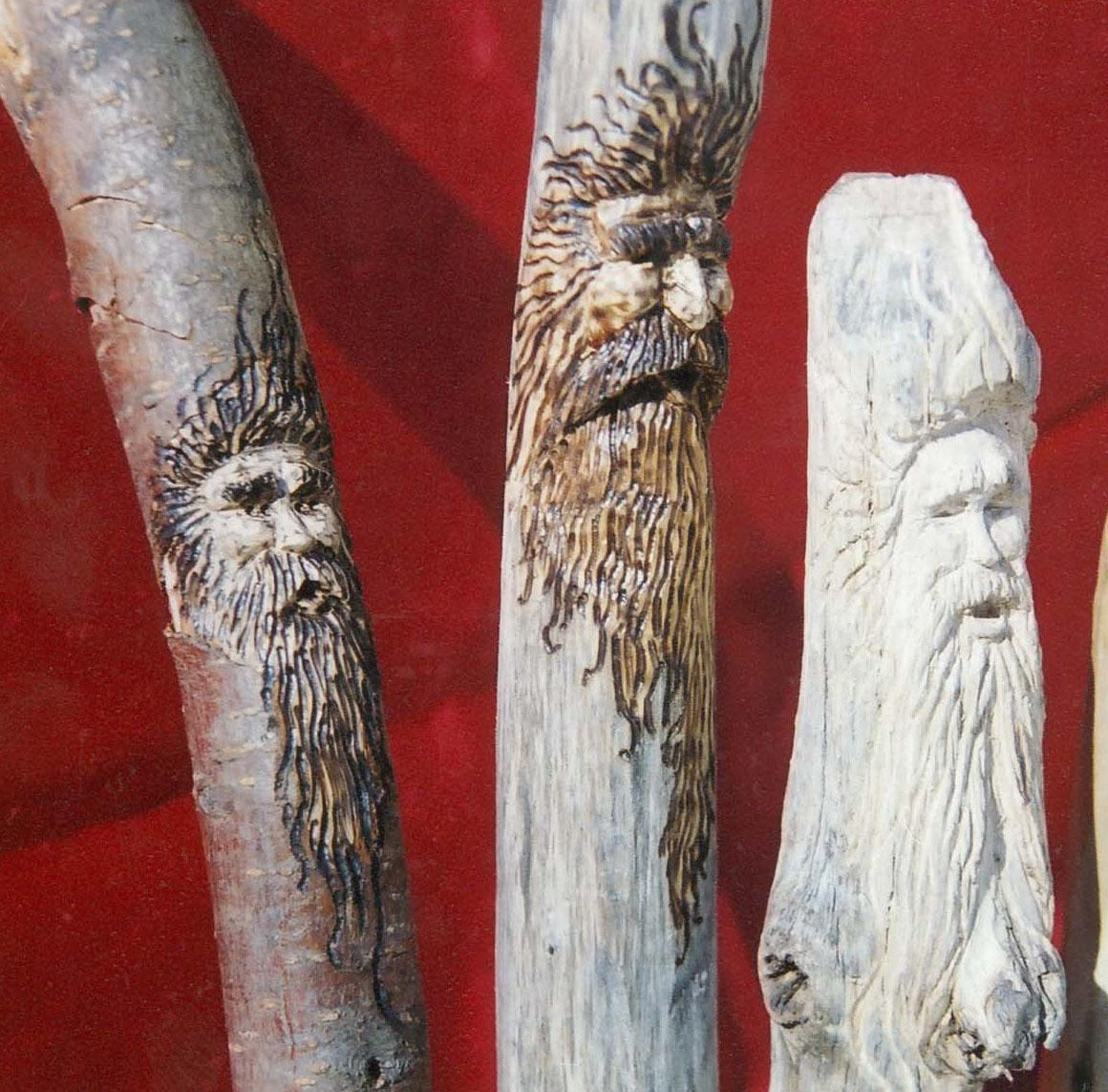 Wood spirit walking sticks by Dan Roesinger of Stark Raven Studios