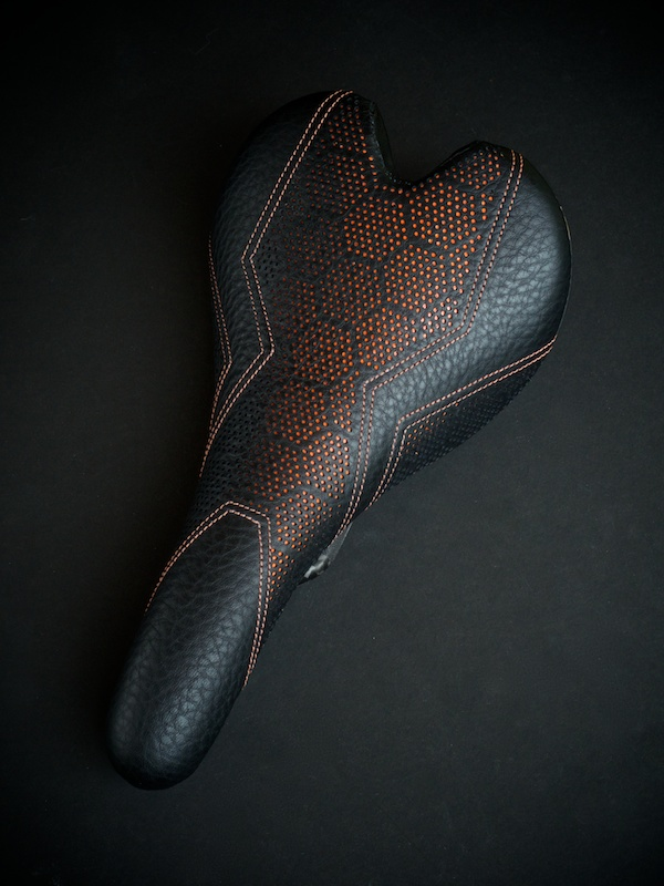Fizik-Fi'Zi-K-Aliante-Carbon-recover-recovered-reupholstered-repaired-leather-black-orange-hexagon-honeycomb-Tron-stitching-handmade-pebbleleather-carbonfiber-lightweight-saddle-seat-bike-bicycle-leatherwork-made-in-Austin-Texas-Busyman-brook (9).jpg