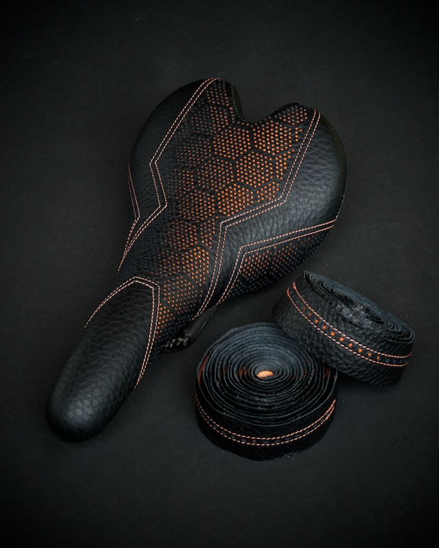 Fizik-Fi'Zi-K-Aliante-Carbon-recover-recovered-reupholstered-repaired-leather-black-orange-hexagon-honeycomb-Tron-stitching-handmade-pebbleleather-carbonfiber-lightweight-saddle-seat-bike-bicycle-leatherwork-made-in-Austin-Texas-Busyman-brook (7).jpg