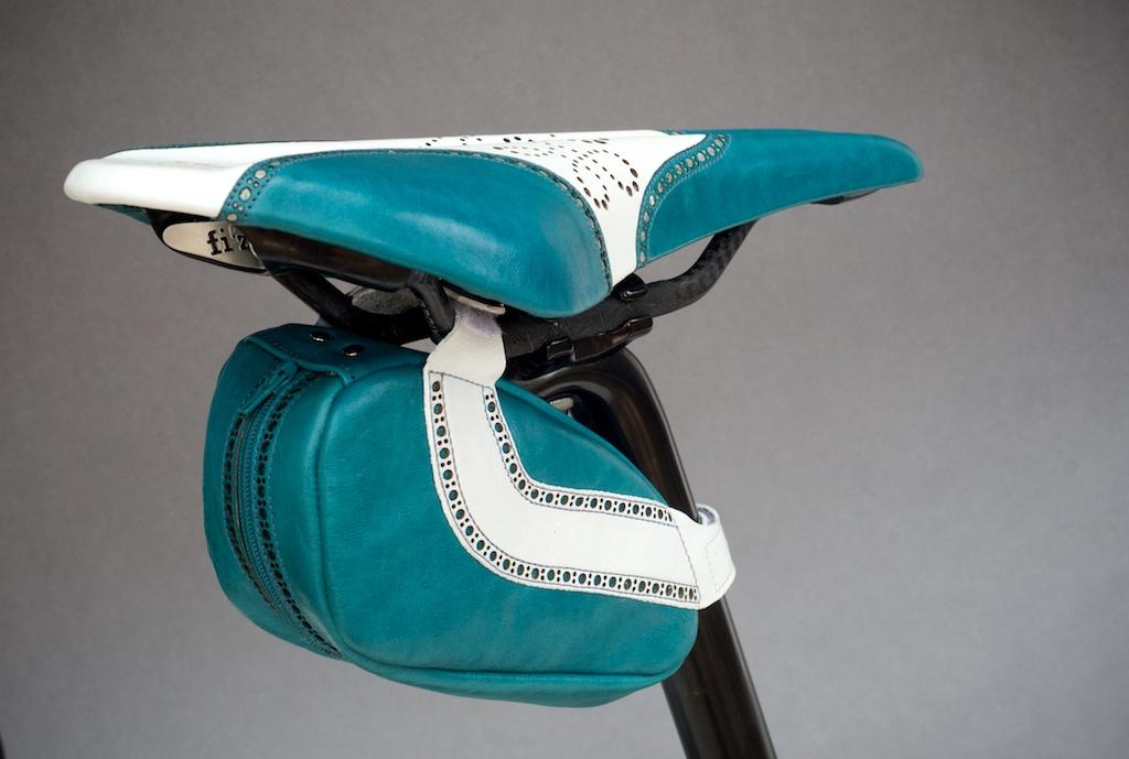 Leh-Seats-Custom-leather-bike-saddles-seats-hand-made-by-carson-leh-Austin-Texas-wingtip-brogue-leather-goods-fizik-Arione-vs-vsx-carbon-blue-white-wingtip-brogue-saddlebag-bar wrap 16.jpg