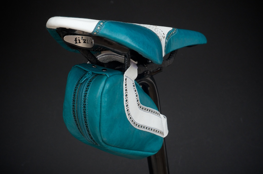 Leh-Seats-Custom-leather-bike-saddles-seats-hand-made-by-carson-leh-Austin-Texas-wingtip-brogue-leather-goods-fizik-Arione-vs-vsx-carbon-blue-white-wingtip-brogue-saddlebag-bar wrap 11.jpg