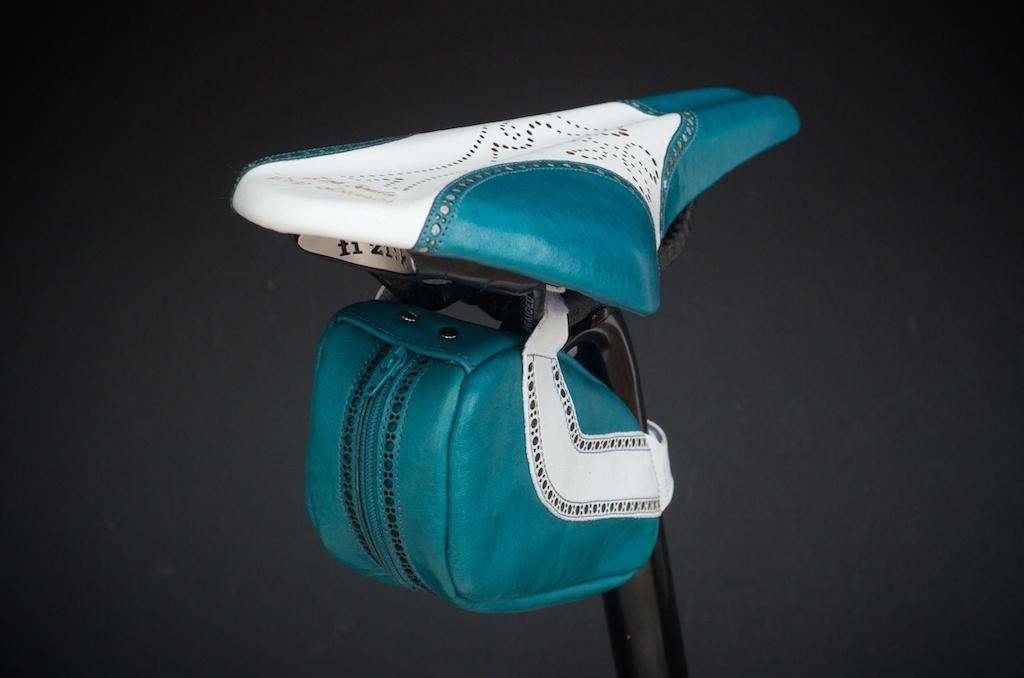 Leh-Seats-Custom-leather-bike-saddles-seats-hand-made-by-carson-leh-Austin-Texas-wingtip-brogue-leather-goods-fizik-Arione-vs-vsx-carbon-blue-white-wingtip-brogue-saddlebag-bar wrap 10.jpg