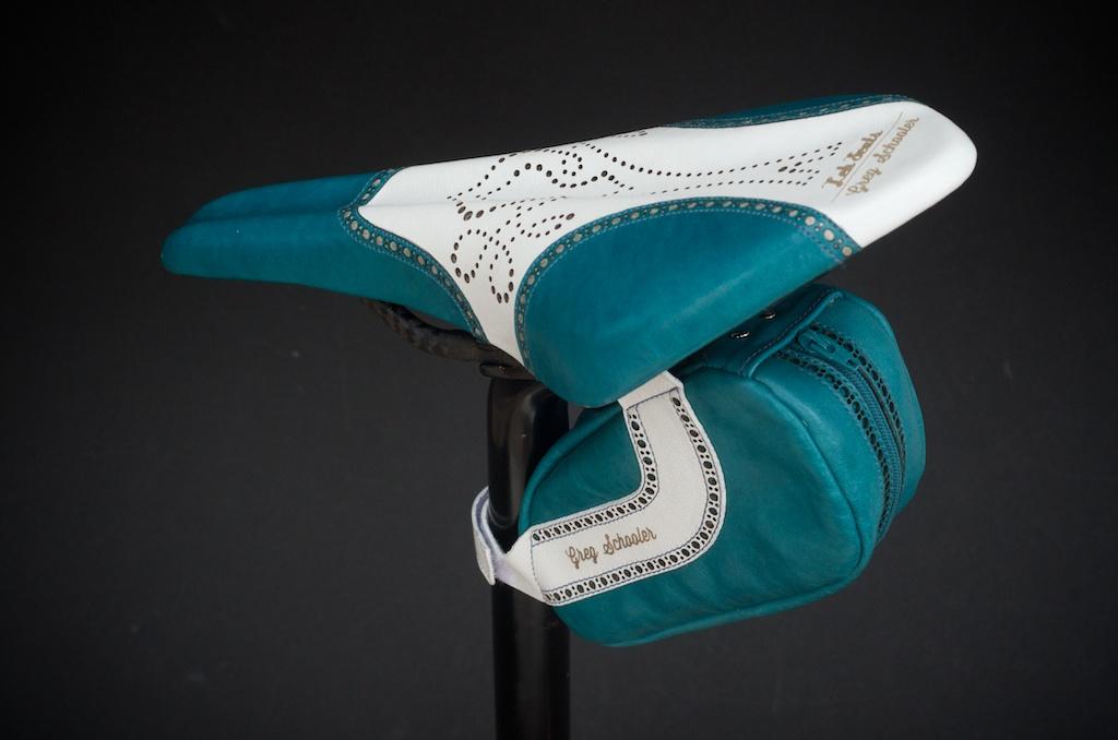 Leh-Seats-Custom-leather-bike-saddles-seats-hand-made-by-carson-leh-Austin-Texas-wingtip-brogue-leather-goods-fizik-Arione-vs-vsx-carbon-blue-white-wingtip-brogue-saddlebag-bar wrap 8.jpg