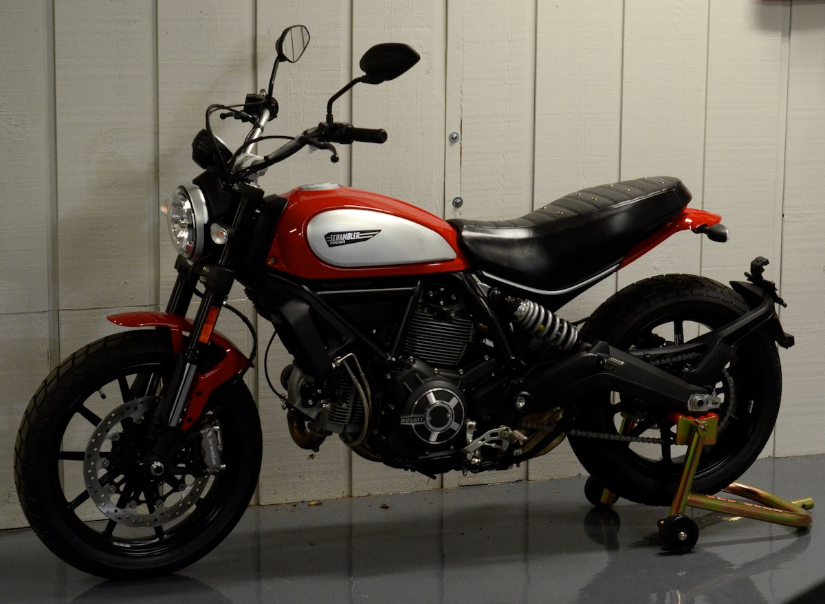 Ducati Scrambler custom leather saddle seat pleated laser cut perforated red suede stitching custom ducati leh saddles obsidian leather goods 1.jpg