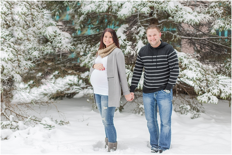 winter-maternity-portraits-in-rochester-mi-at-the-royal-park-hotel-by-courtney-carolyn-photography_0008.jpg