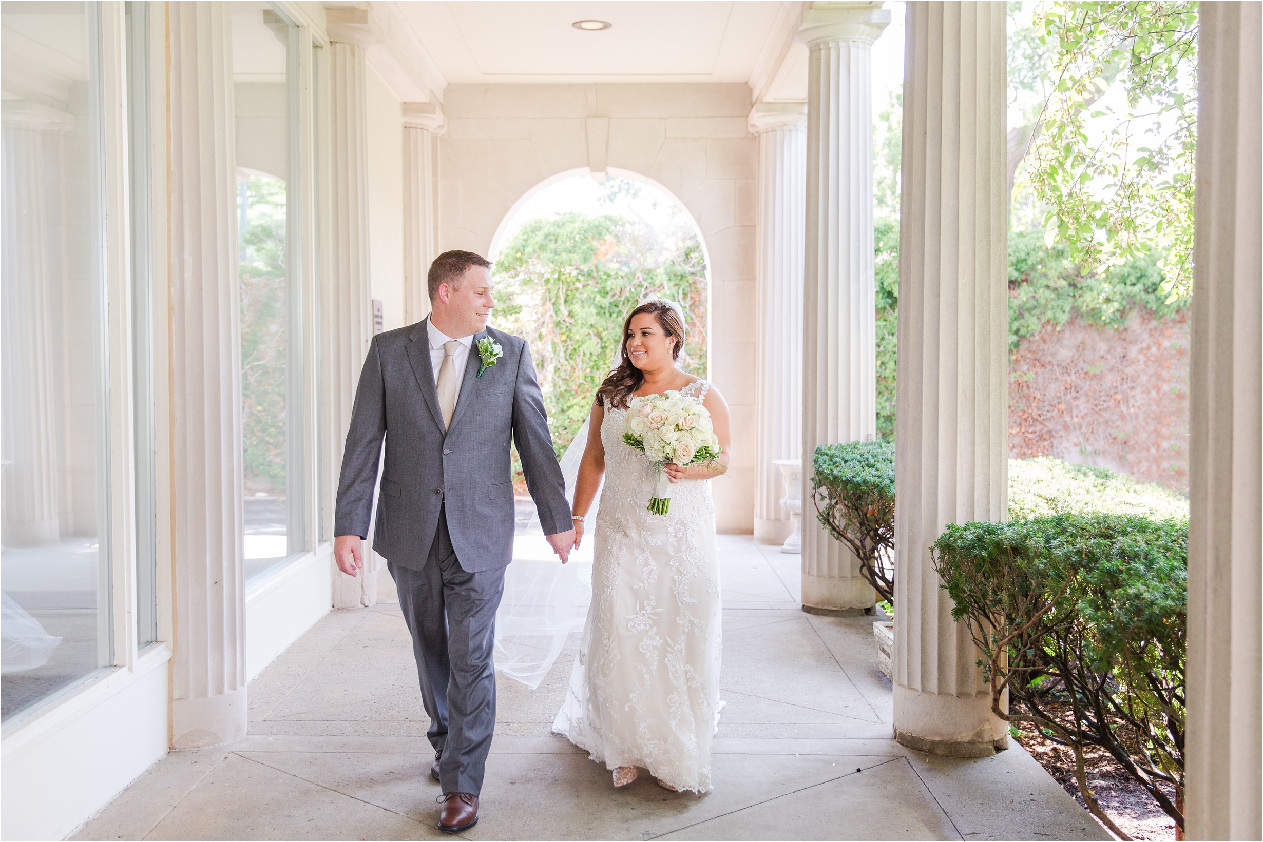 romantic-timeless-candid-wedding-photos-at-the-war-memorial-in-grosse-pointe-mi-by-courtney-carolyn-photography_0004.jpg