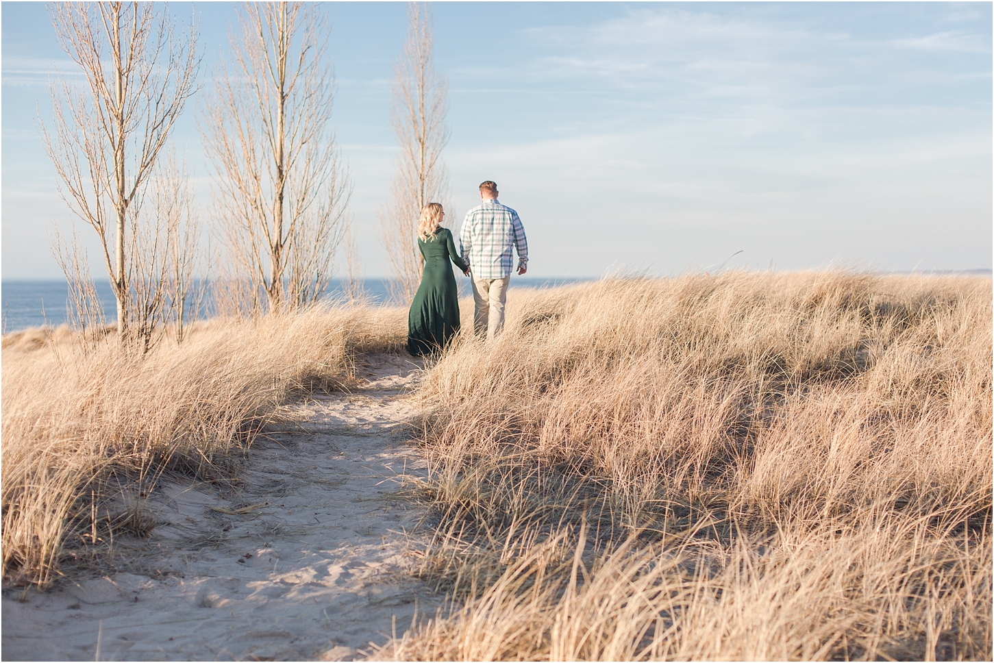 romantic-sunset-beach-engagement-photos-at-silver-beach-in-saint-joseph-mi-by-courtney-carolyn-photography_0004.jpg