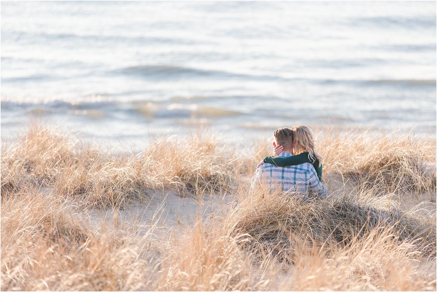 romantic-sunset-beach-engagement-photos-at-silver-beach-in-saint-joseph-mi-by-courtney-carolyn-photography_0008.jpg