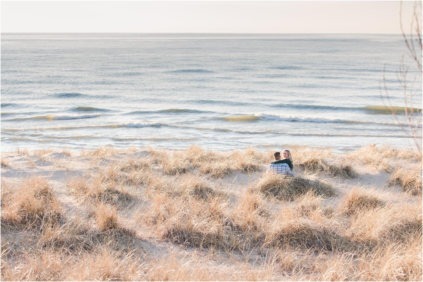 romantic-sunset-beach-engagement-photos-at-silver-beach-in-saint-joseph-mi-by-courtney-carolyn-photography_0014.jpg