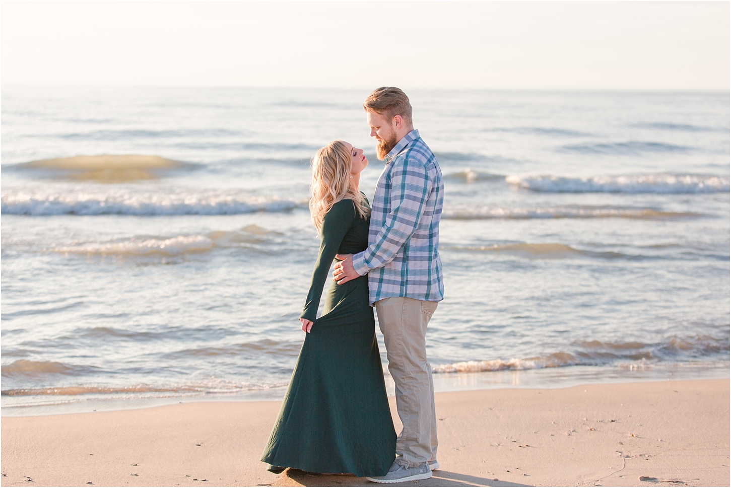romantic-sunset-beach-engagement-photos-at-silver-beach-in-saint-joseph-mi-by-courtney-carolyn-photography_0017.jpg