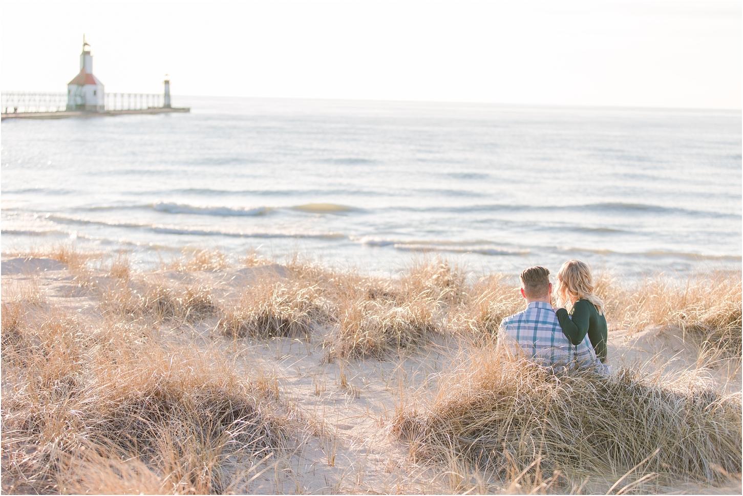 romantic-sunset-beach-engagement-photos-at-silver-beach-in-saint-joseph-mi-by-courtney-carolyn-photography_0025.jpg