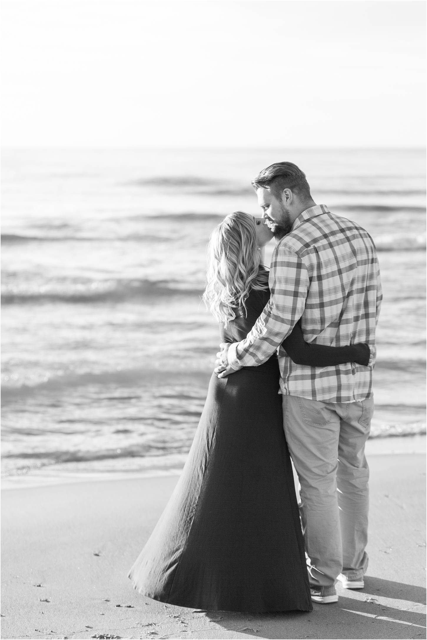 romantic-sunset-beach-engagement-photos-at-silver-beach-in-saint-joseph-mi-by-courtney-carolyn-photography_0029.jpg