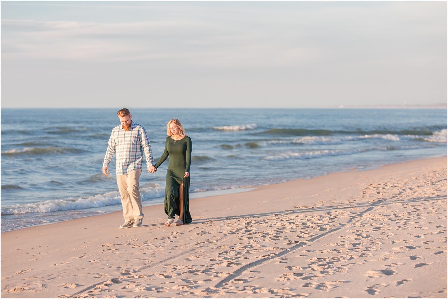 romantic-sunset-beach-engagement-photos-at-silver-beach-in-saint-joseph-mi-by-courtney-carolyn-photography_0034.jpg