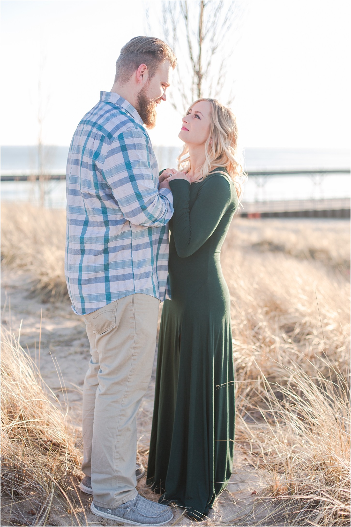 romantic-sunset-beach-engagement-photos-at-silver-beach-in-saint-joseph-mi-by-courtney-carolyn-photography_0033.jpg