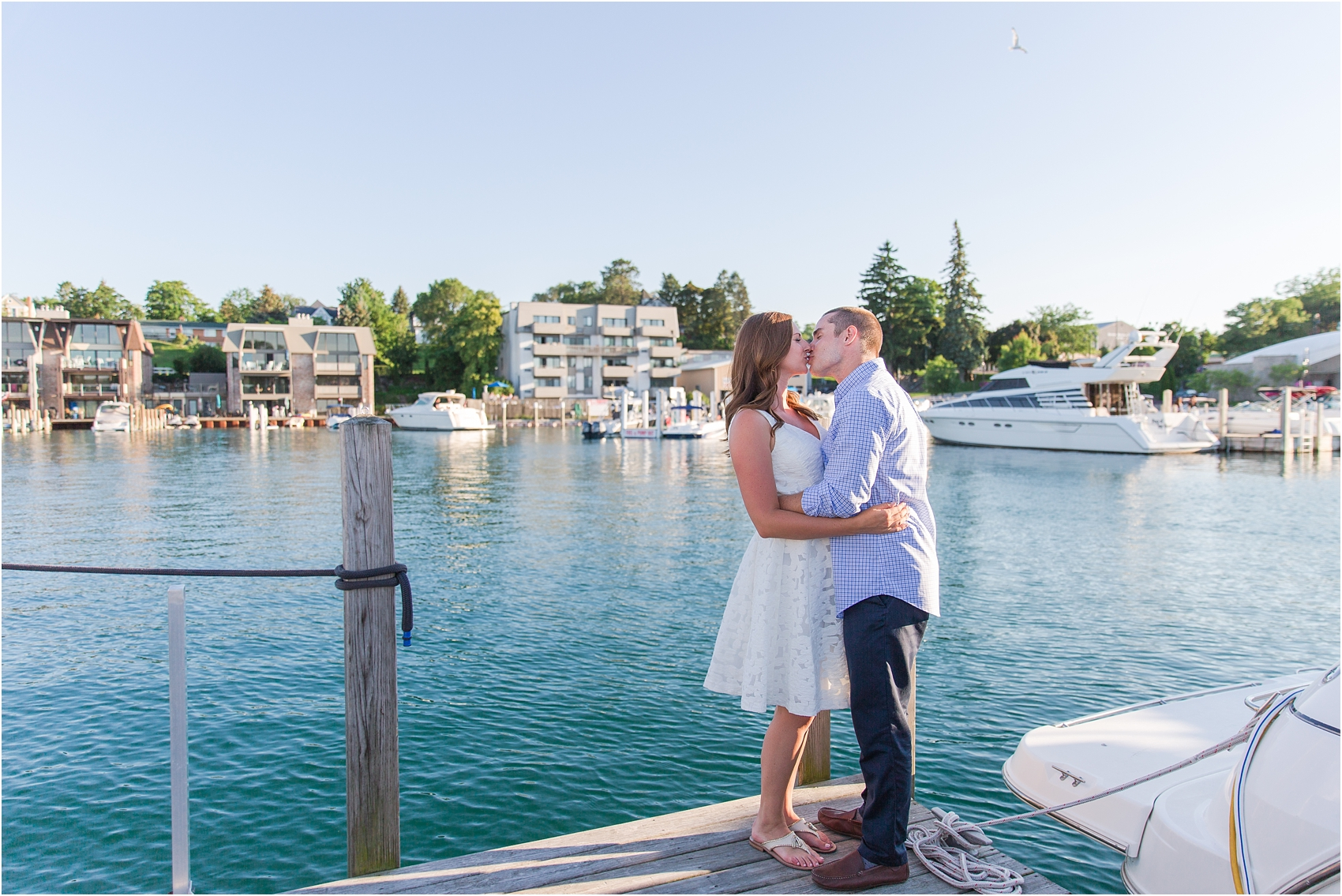 romantic-sunset-engagement-photos-in-downtown-charlevoix-mi-by-courtney-carolyn-photography_0005.jpg