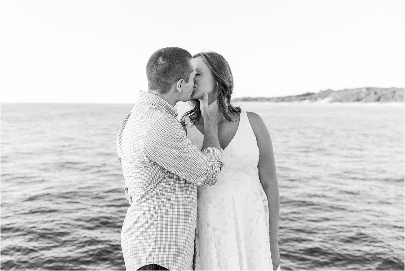 romantic-sunset-engagement-photos-at-the-lighthouse-in-charlevoix-mi-by-courtney-carolyn-photography_0012.jpg