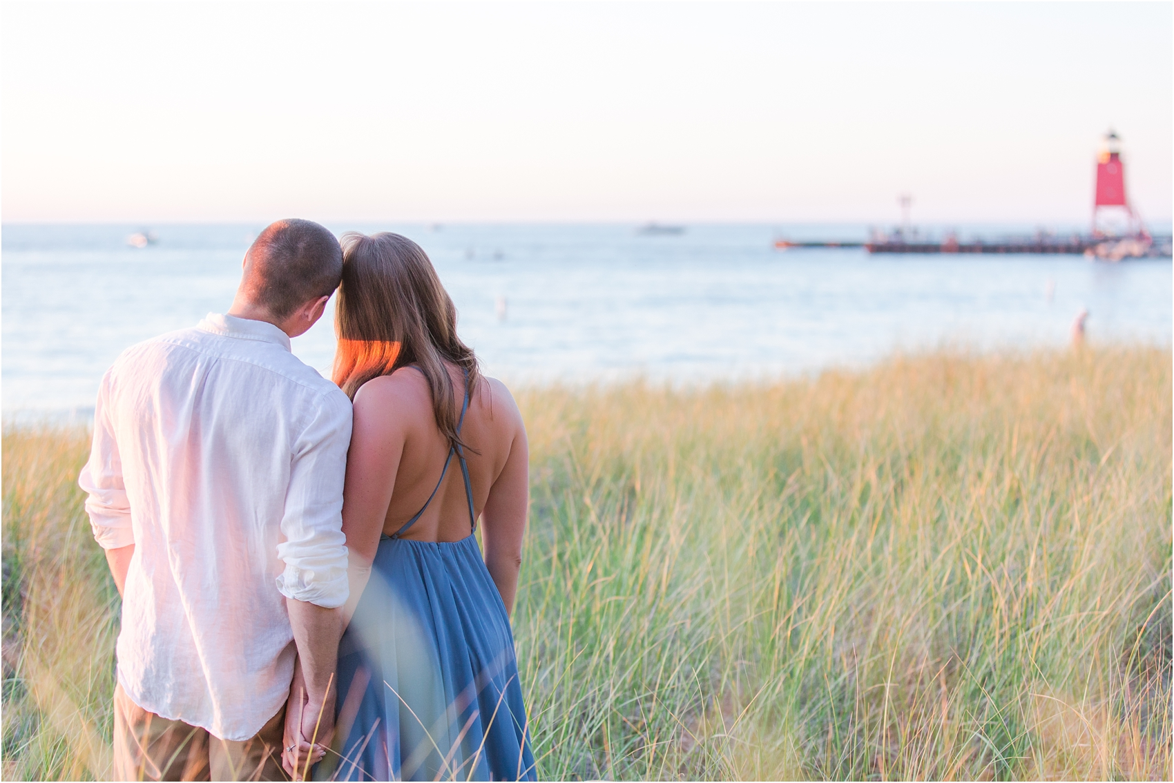 romantic-sunset-engagement-photos-at-michigan-beach-park-in-charlevoix-mi-by-courtney-carolyn-photography_0014.jpg