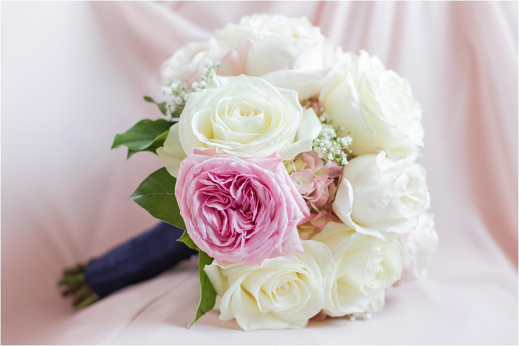 joyful-and-candid-navy-blush-wedding-photos-at-crystal-gardens-in-howell-mi-by-courtney-carolyn-photography_0005.jpg