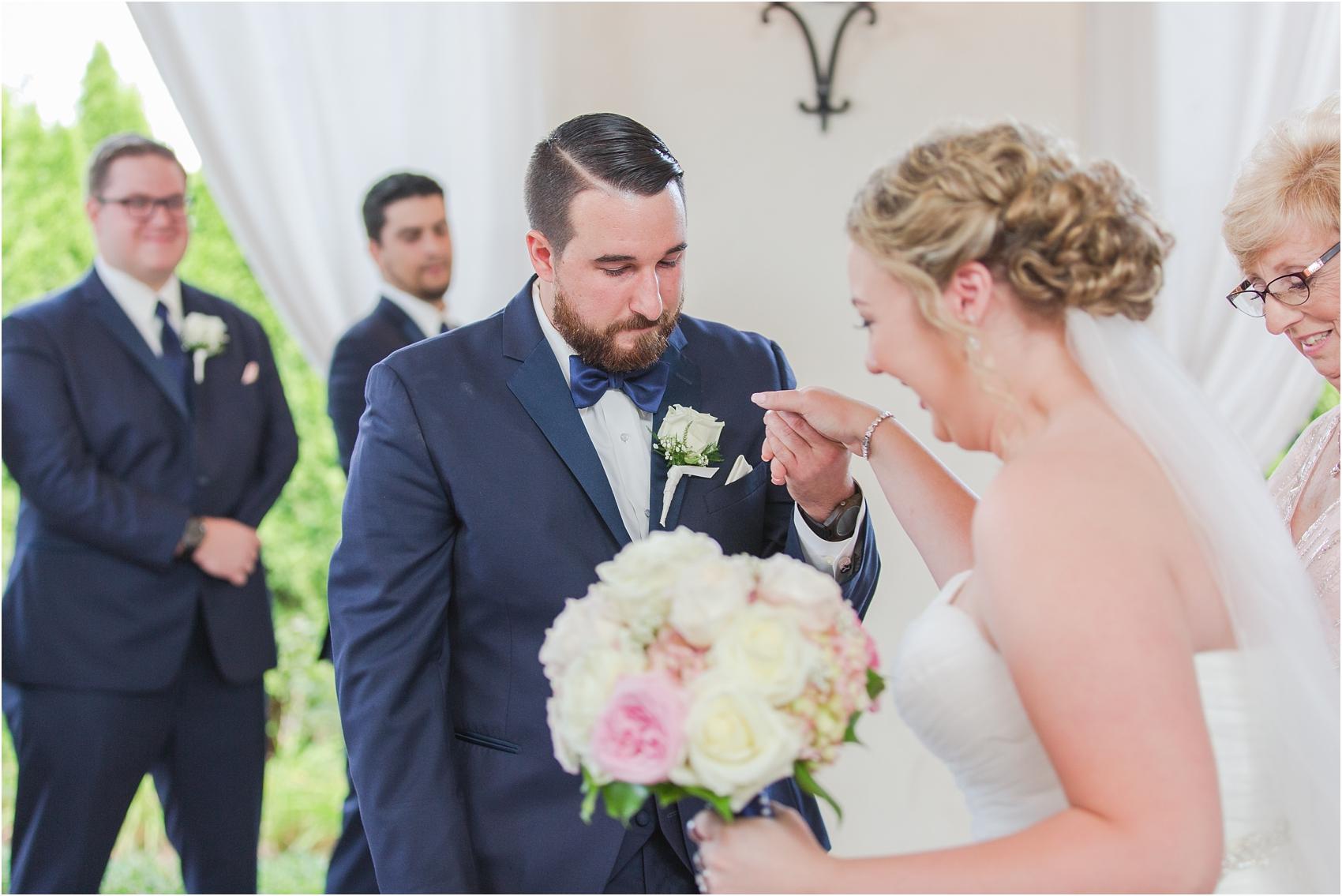 joyful-and-candid-navy-blush-wedding-photos-at-crystal-gardens-in-howell-mi-by-courtney-carolyn-photography_0034.jpg