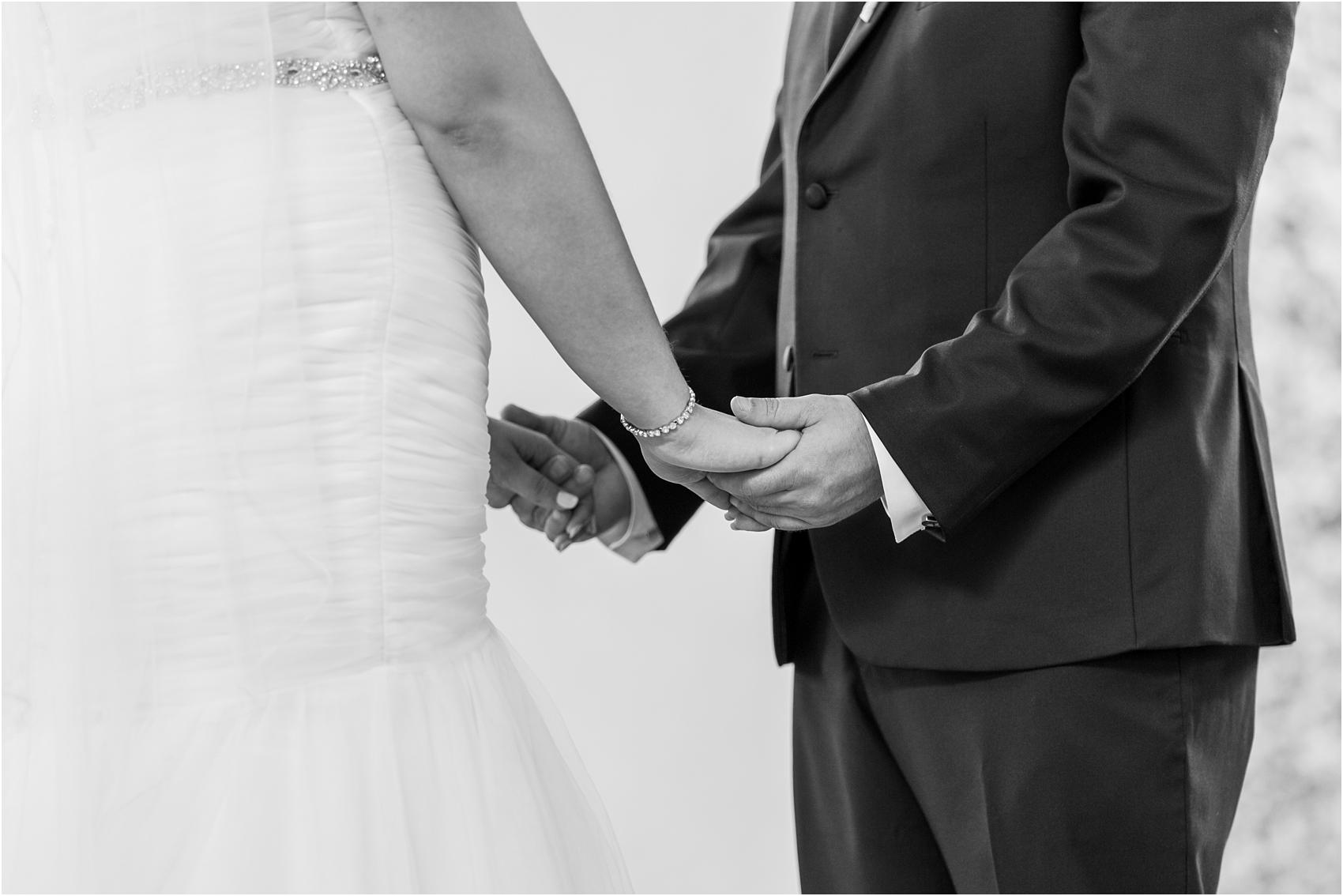 joyful-and-candid-navy-blush-wedding-photos-at-crystal-gardens-in-howell-mi-by-courtney-carolyn-photography_0038.jpg