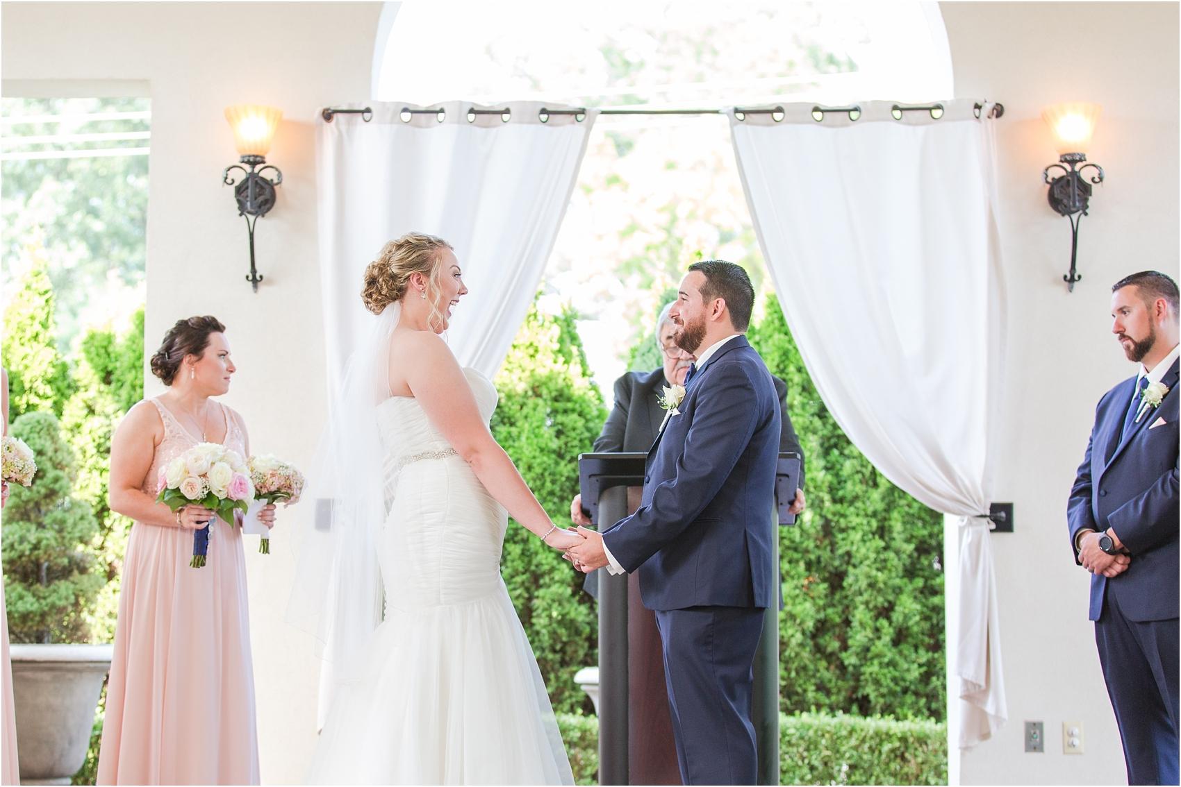 joyful-and-candid-navy-blush-wedding-photos-at-crystal-gardens-in-howell-mi-by-courtney-carolyn-photography_0052.jpg