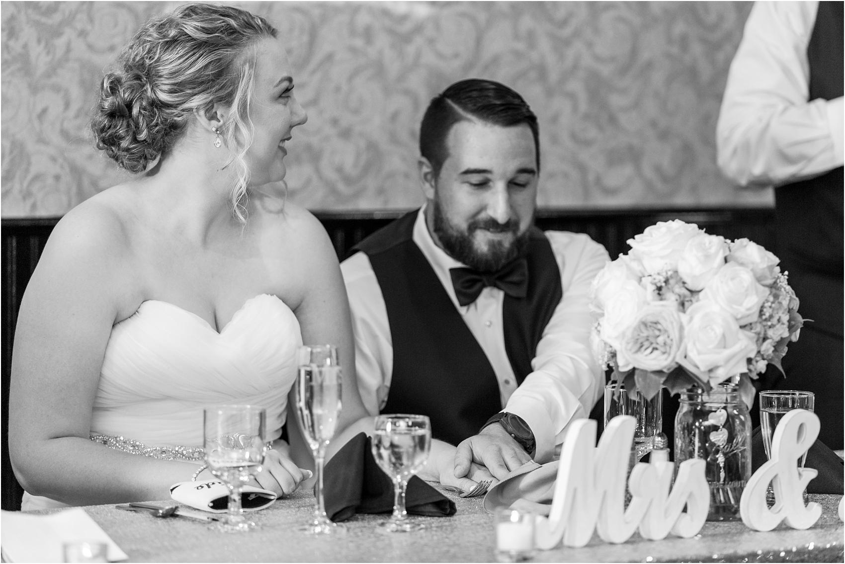 joyful-and-candid-navy-blush-wedding-photos-at-crystal-gardens-in-howell-mi-by-courtney-carolyn-photography_0081.jpg