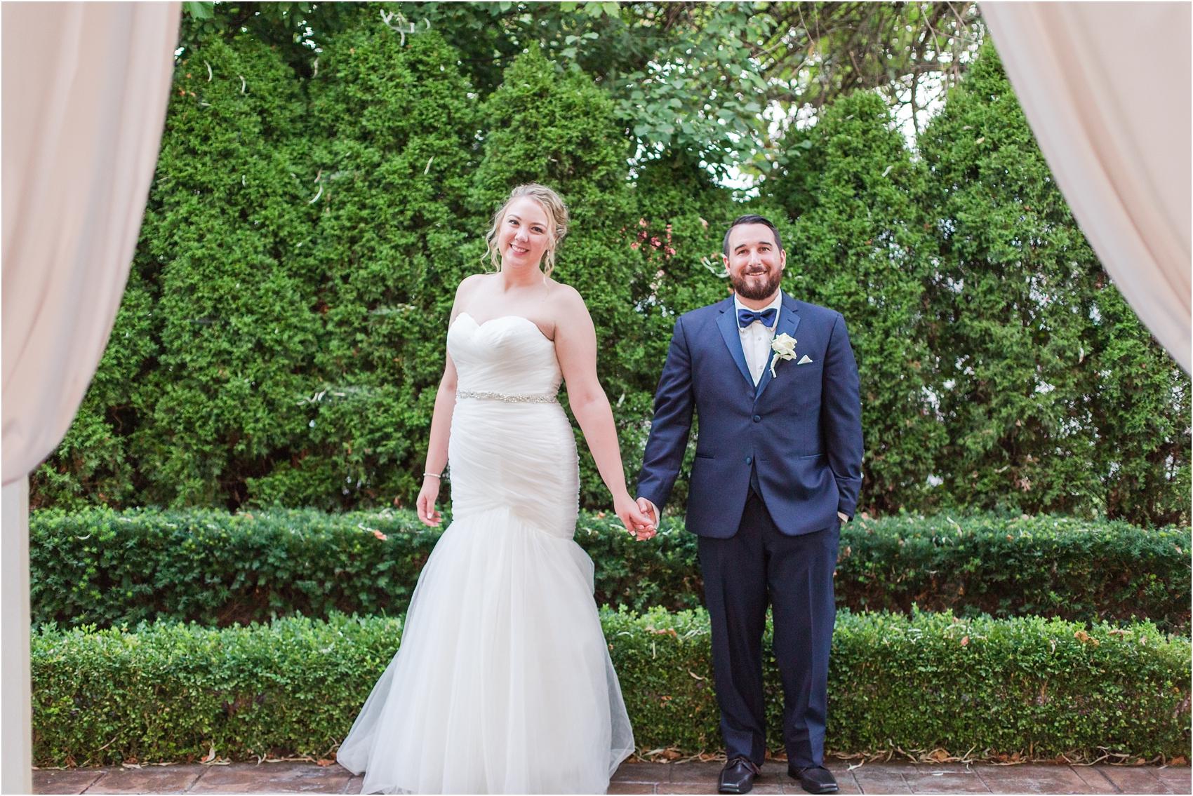 joyful-and-candid-navy-blush-wedding-photos-at-crystal-gardens-in-howell-mi-by-courtney-carolyn-photography_0104.jpg