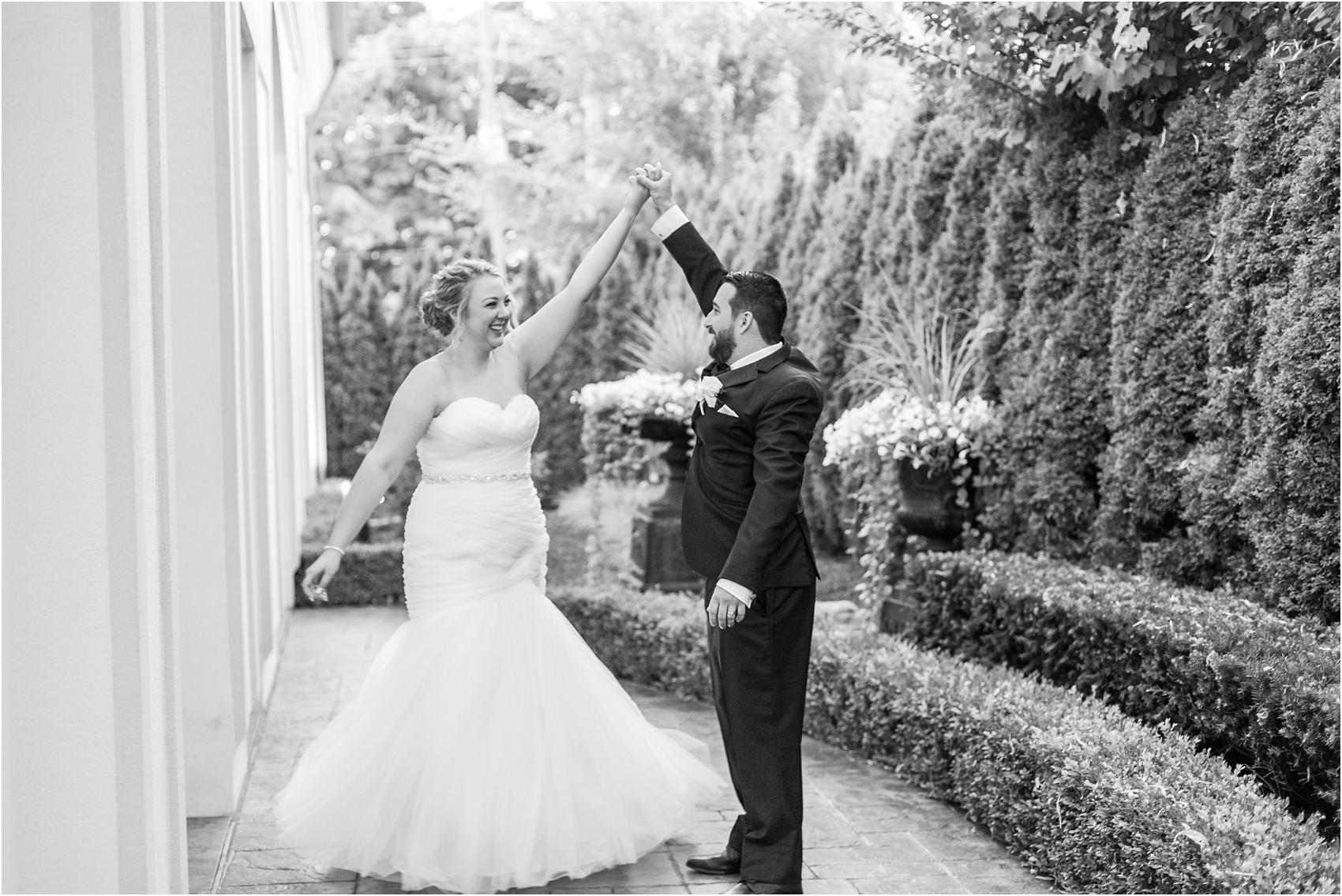 joyful-and-candid-navy-blush-wedding-photos-at-crystal-gardens-in-howell-mi-by-courtney-carolyn-photography_0110.jpg