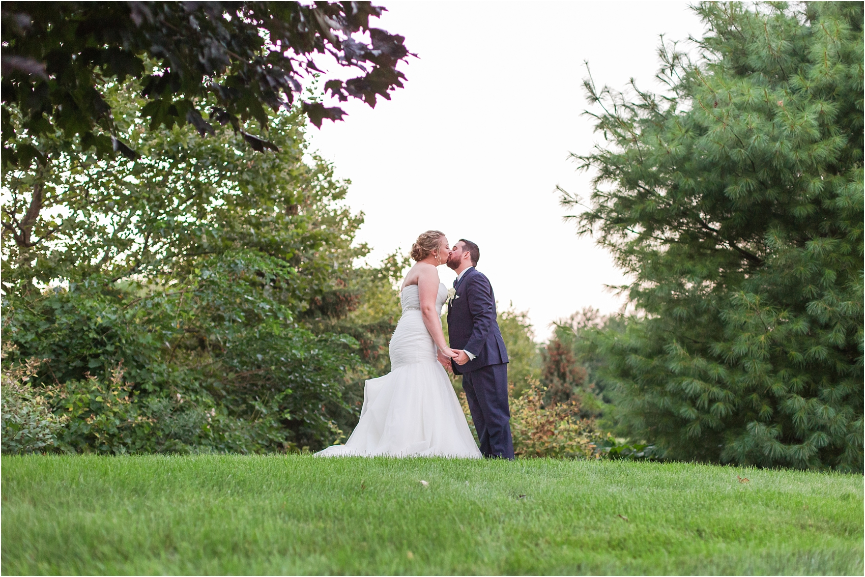 joyful-and-candid-navy-blush-wedding-photos-at-crystal-gardens-in-howell-mi-by-courtney-carolyn-photography_0117.jpg
