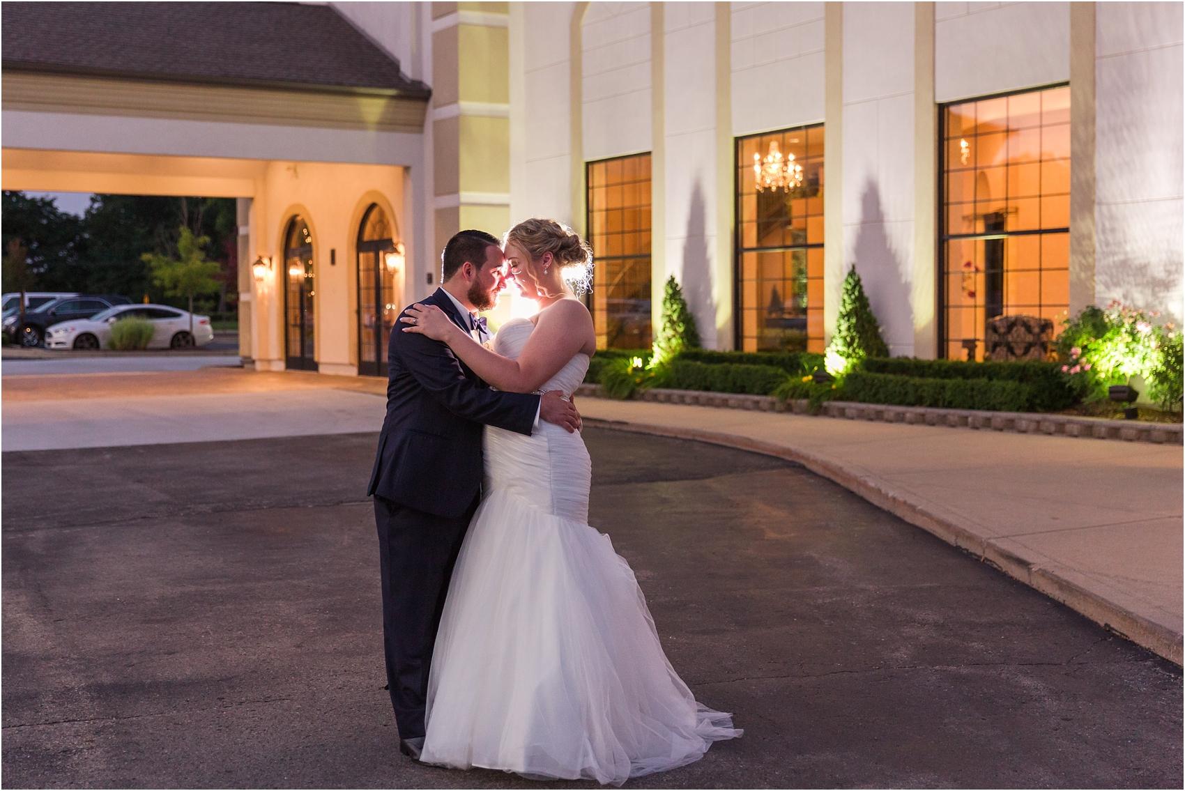 joyful-and-candid-navy-blush-wedding-photos-at-crystal-gardens-in-howell-mi-by-courtney-carolyn-photography_0121.jpg