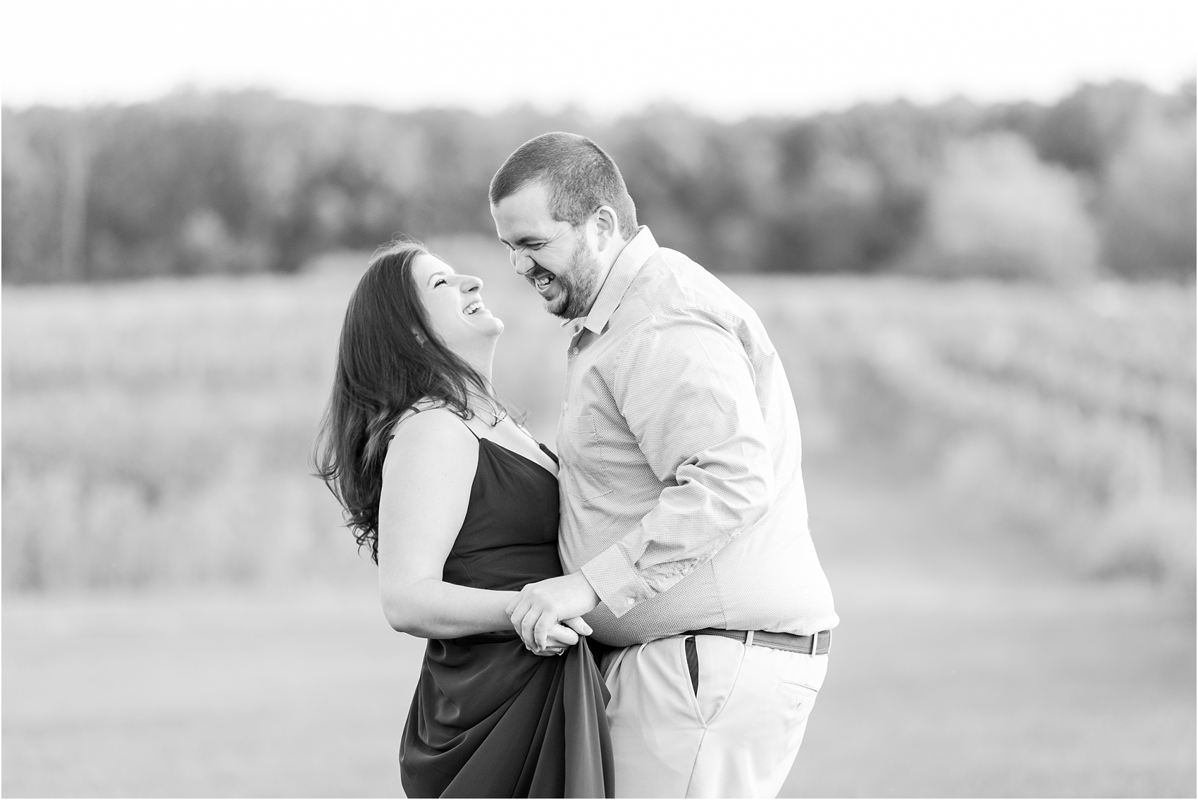 candid-romantic-summer-engagement-photos-at-hidden-lake-gardens-and-black-fire-winery-in-tipton-mi-by-courtney-carolyn-photography_0003.jpg