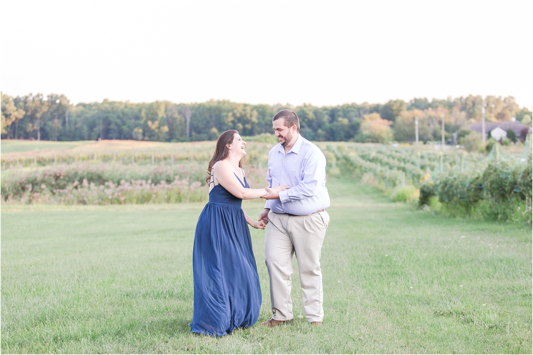 candid-romantic-summer-engagement-photos-at-hidden-lake-gardens-and-black-fire-winery-in-tipton-mi-by-courtney-carolyn-photography_0006.jpg