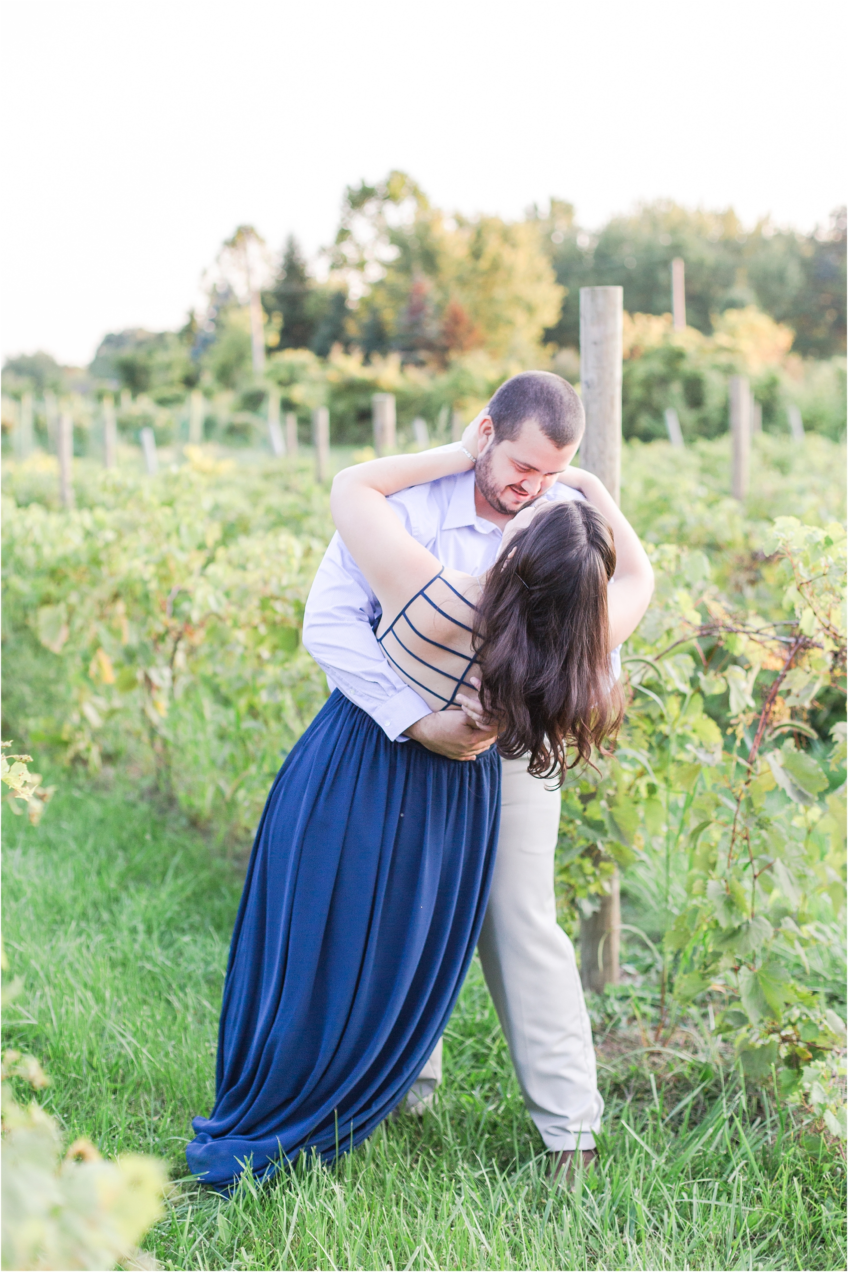 candid-romantic-summer-engagement-photos-at-hidden-lake-gardens-and-black-fire-winery-in-tipton-mi-by-courtney-carolyn-photography_0009.jpg