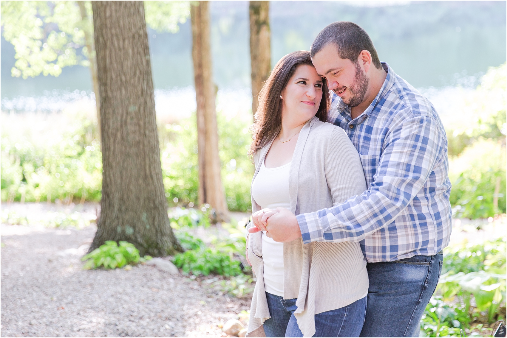 candid-romantic-summer-engagement-photos-at-hidden-lake-gardens-and-black-fire-winery-in-tipton-mi-by-courtney-carolyn-photography_0022.jpg