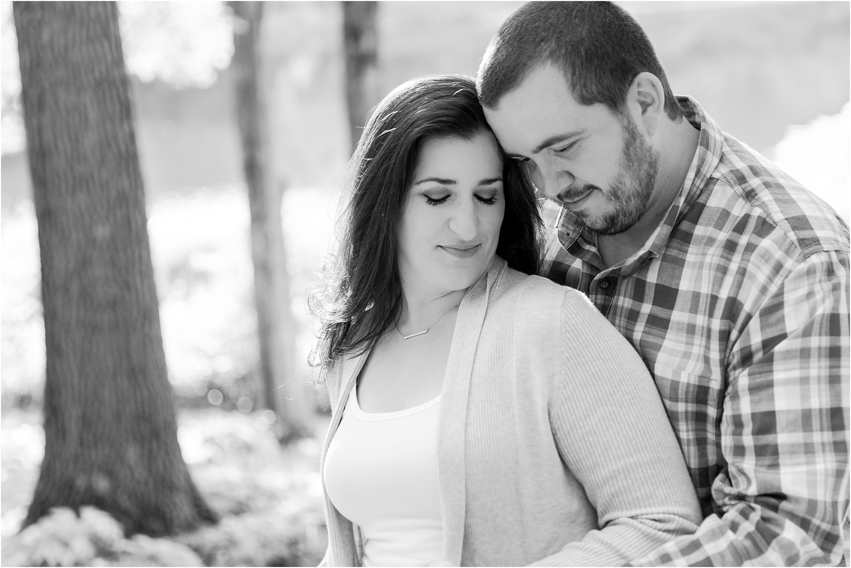 candid-romantic-summer-engagement-photos-at-hidden-lake-gardens-and-black-fire-winery-in-tipton-mi-by-courtney-carolyn-photography_0033.jpg