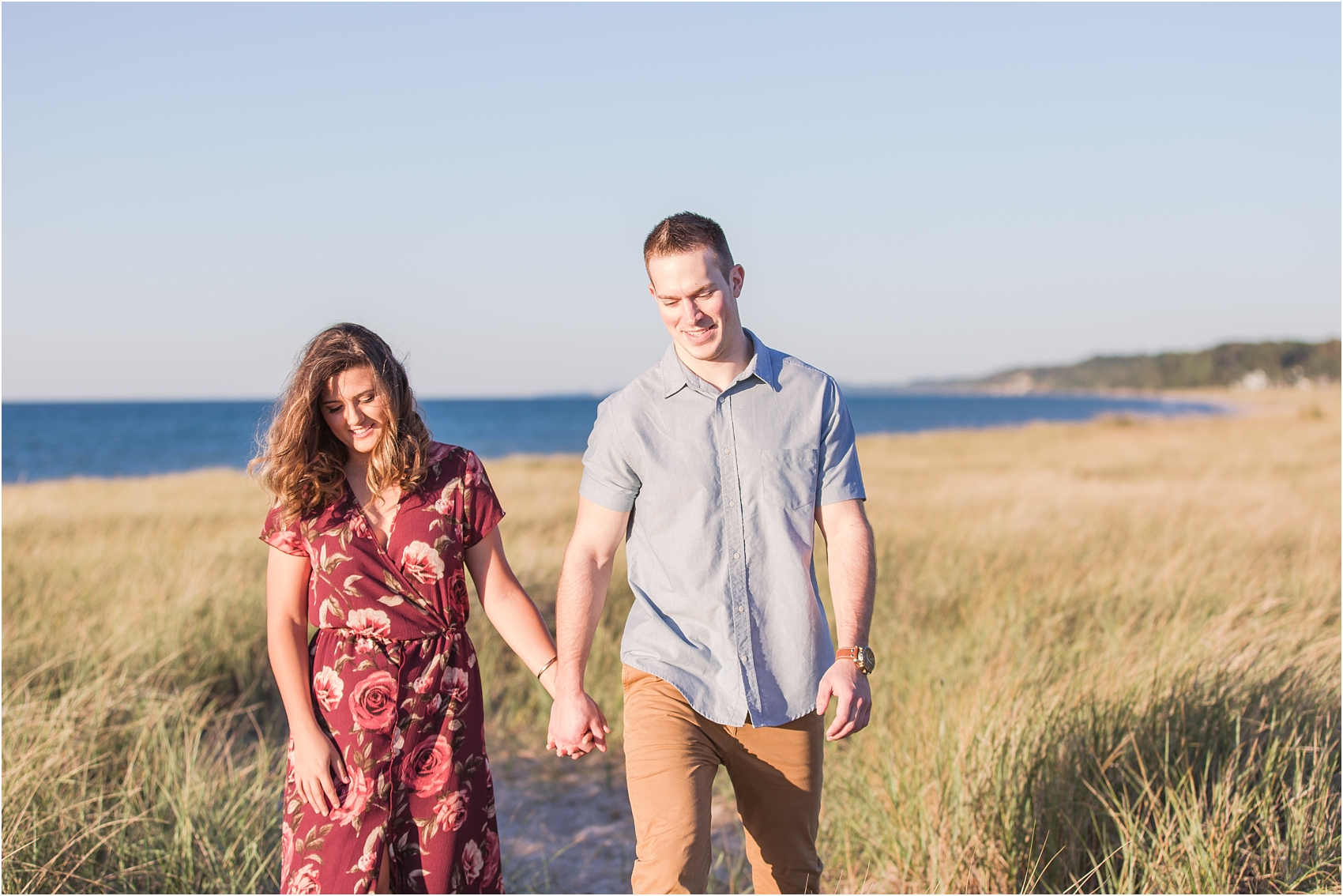 candid-end-of-summer-sunset-engagement-photos-at-silver-beach-in-st-joseph-mi-by-courtney-carolyn-photography_0007.jpg