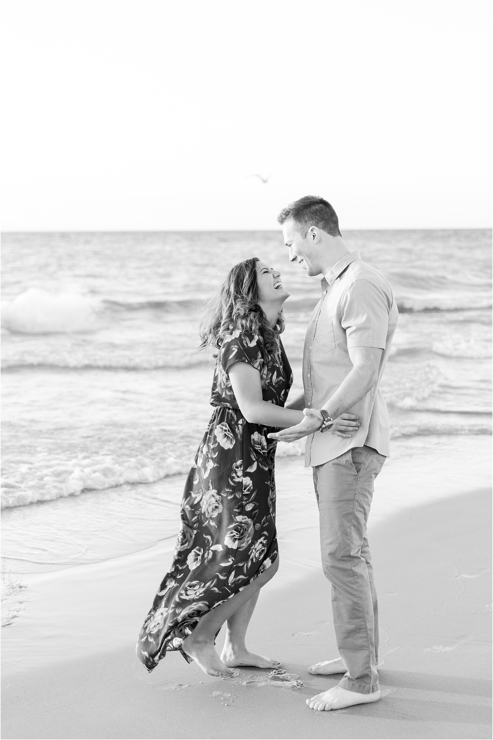 candid-end-of-summer-sunset-engagement-photos-at-silver-beach-in-st-joseph-mi-by-courtney-carolyn-photography_0024.jpg