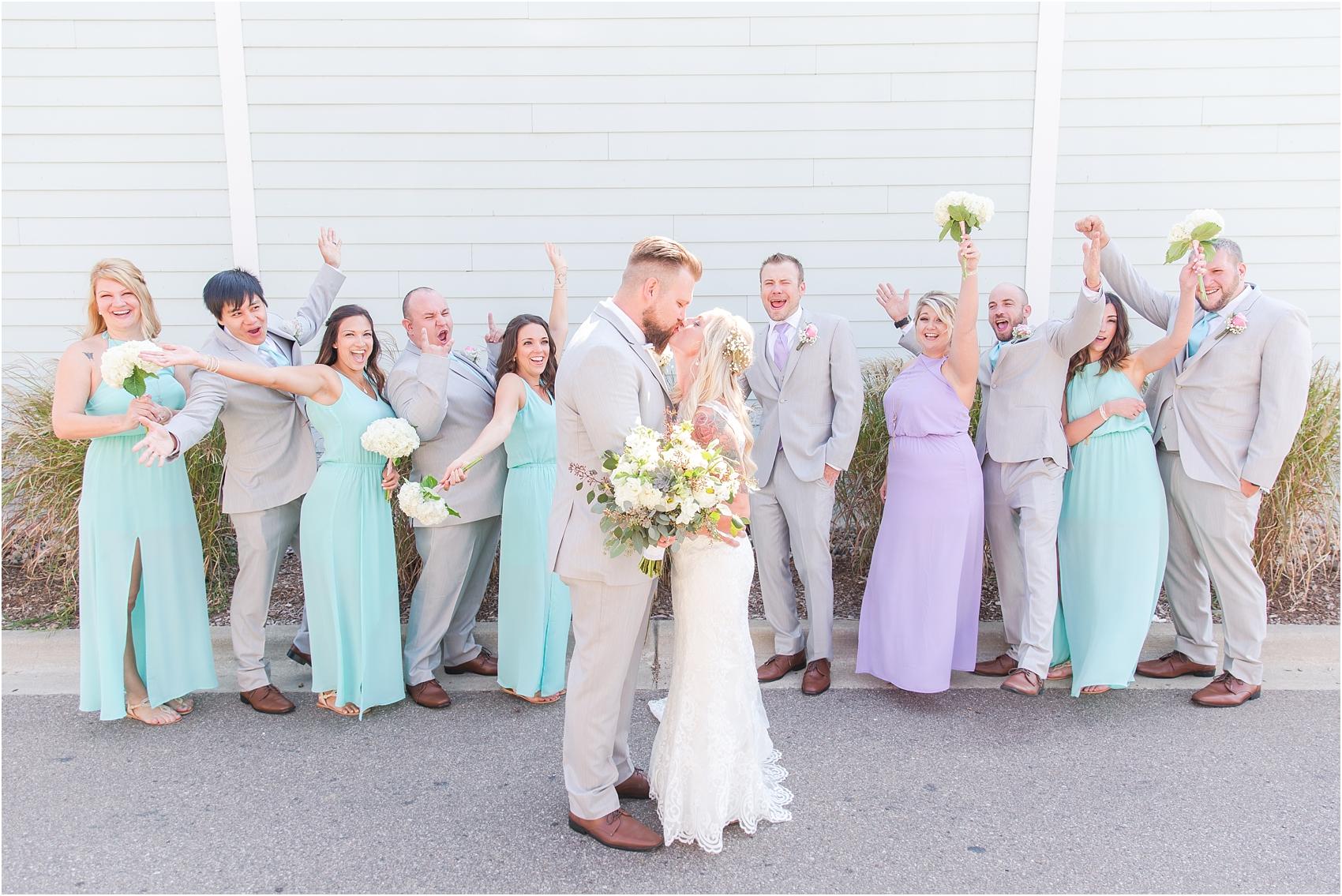 fun-whimsical-beach-wedding-photos-in-st-joseph-michigan-by-courtney-carolyn-photography_0050.jpg